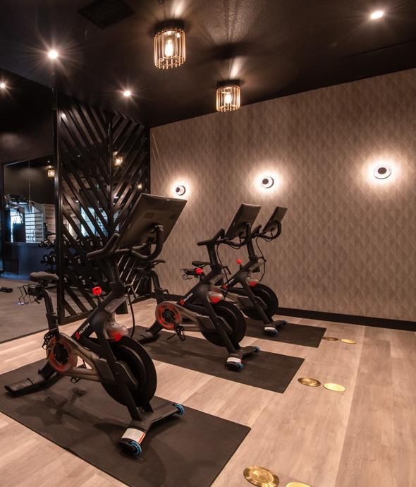 mood lighting fitness workout bike room with three bike aligned