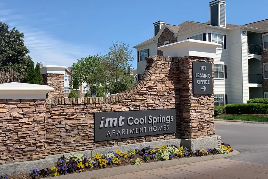 Video thumbnail for Cool Springs with driveway and stone monument sign.