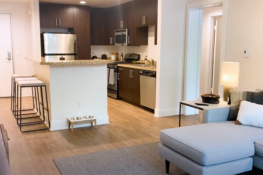 Video tour thumbnail for Gallery 421 with apartment living room and kitchen with island breakfast bar.