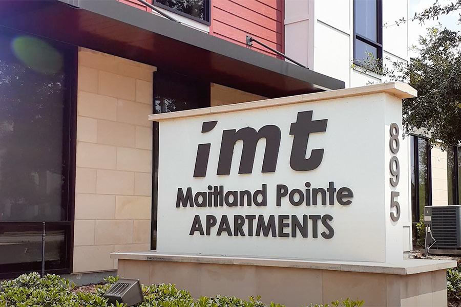Video tour thumbnail for Maitland Pointe with large monument sign next to apartment building.