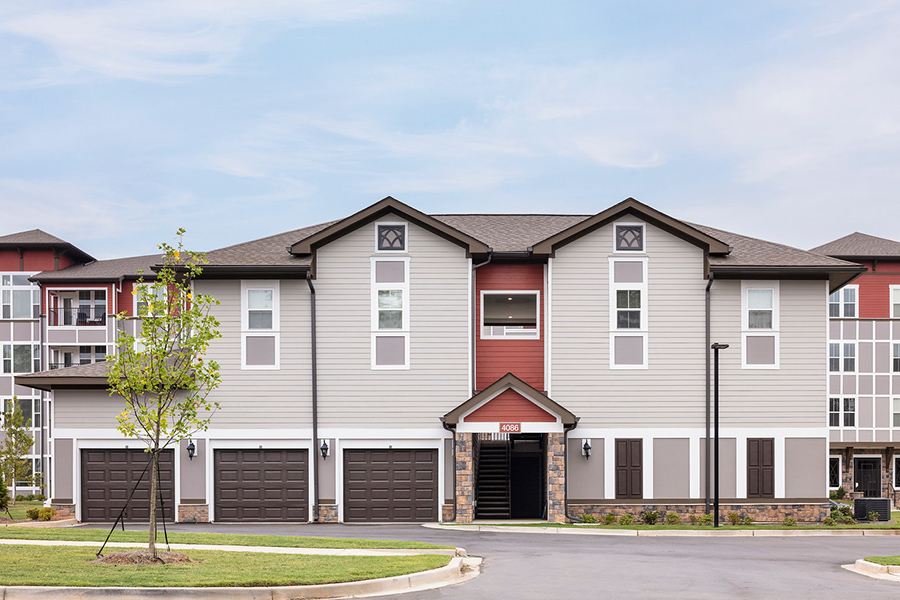 Carriage house apartments with garages.