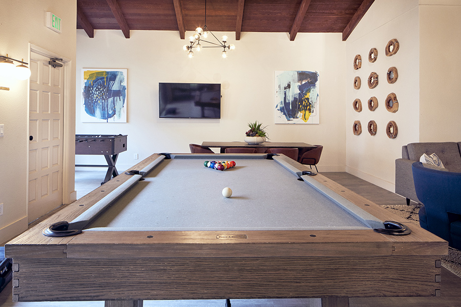 Detail of wood pool table in lounge area.